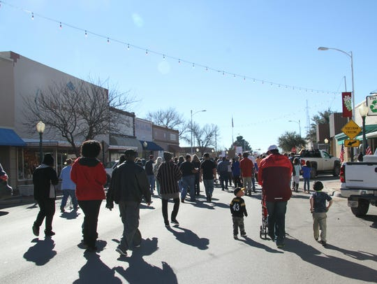 Carlsbad residents marched on Canyon Street from the