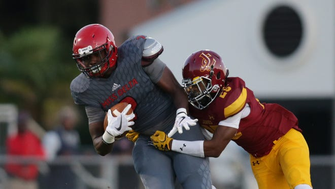 JCJC's Jalon Scott (right) tackles Mississippi Delta's Raheem Moore during last week's game.