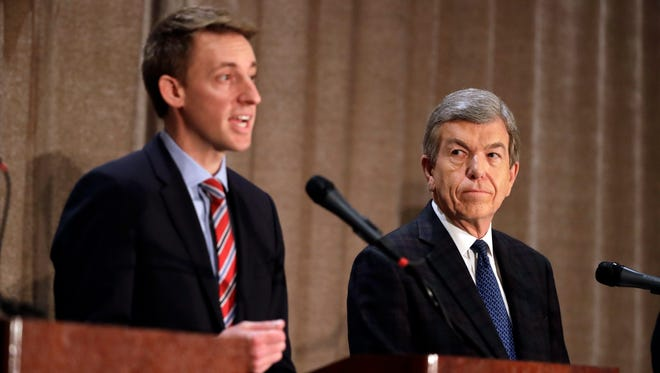 Democratic candidate Jason Kander, left, speaks alongside Republican incumbent Sen. Roy Blunt during the first debate in Missouri's Senate race on Sept. 30, 2016, in Branson, Mo.