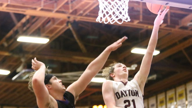 Dayton's Tanner Lewis (right) scores the ball against Cascade Christian on Friday, March 3, 2017.