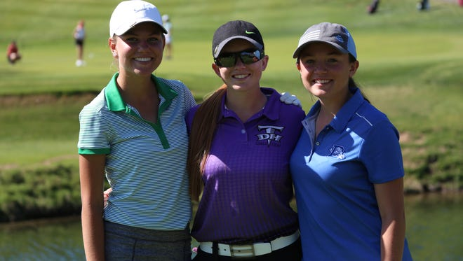 Snow Canyon's Lexi Hamel (left), Desert Hills' Tori Thomas (center) and Dixie's Gracie Richens (right) pose for a picture at Dixie Red Hills. All three golfers tied for first at the 3A state tournament with Thomas winning in a three-way playoff.