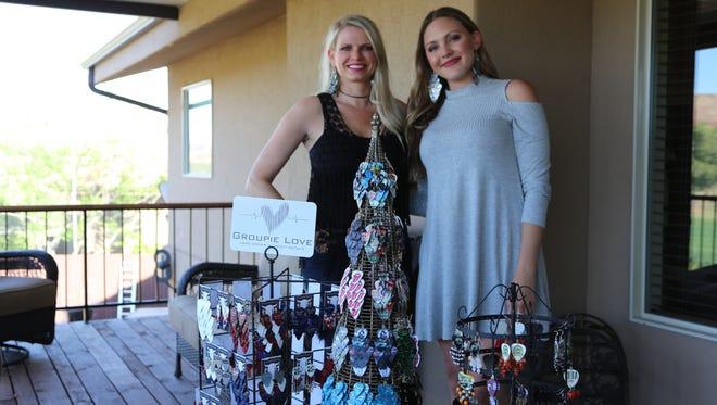 From left, Mary Callahan and Kylie Kennedy of Groupie Love Designs create pieces of jewelry from guitar picks, strings and all-natural gemstones. The pieces are inspired by rock music.
