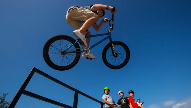 Dalton McCollum, 14, of Cape Coral, soars through the air while riding his bike at Eagle Skate Park in Cape Coral Friday, May 26, 2017. Kids were in attendance at the park as local schools concluded their academic year and students began their summer vacation.