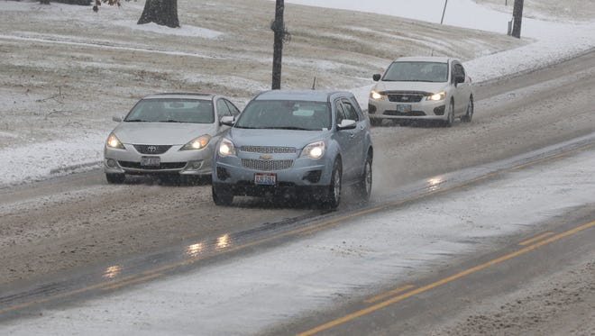 Ice and snow coats cars and roads in Springfield Township Wednesday