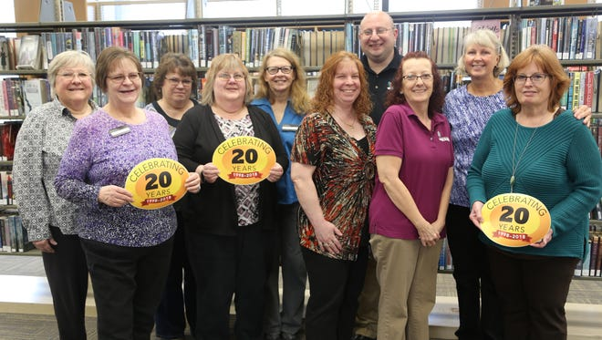 Capital Area District Libraries celebrates 20 years in operation this year, along with these employees who have been there from the beginning.