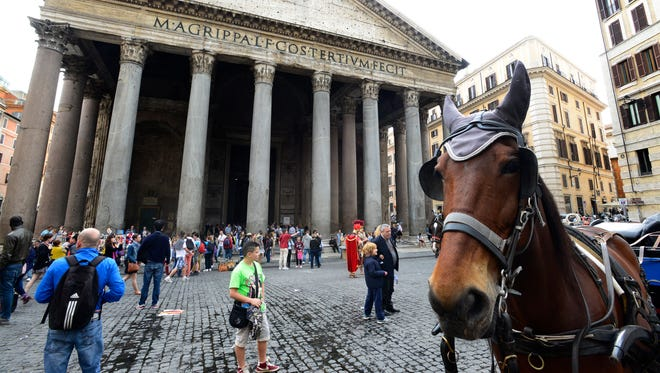 A horse in period clothing at the Pantheon in Rome.