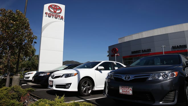 New Toyota cars are displayed at Toyota Marin in California