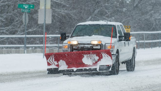 A commercial plow truck drives on College Avenue in Salisbury in this file photo.
