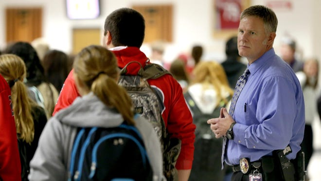 Before October, Neenah High School Police Liaison Officer Pat Pedersen could not carry a weapon at after-school events. Act 23 makes it legal for off-duty, retired and out-of-state police officers to carry weapons on school grounds in Wisconsin.
