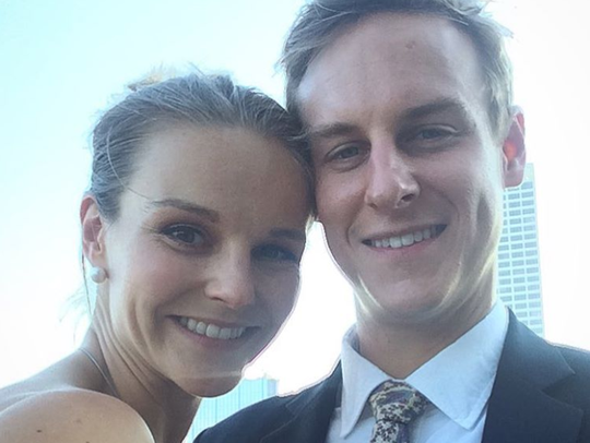 Tatiana Mirutenko and James Hoover smile for a photo during a wedding in Milwaukee in June 2016.