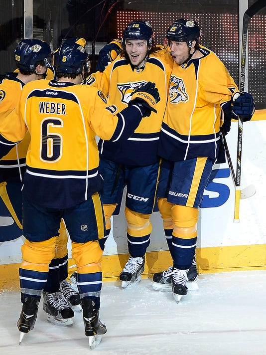 Nashville Predators forward Calle Jarnkrok (19), of Sweden, celebrates with teammates Roman Josi (59), of Switzerland, left, Shea Weber (6) and Craig Smith (15) after scoring his first NHL goal in the first period of an NHL hockey game against the Buffalo Sabres, Thursday, March 27, 2014, in Nashville, Tenn.  (AP Photo/Mark Zaleski)
