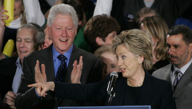 Hillary Cinton and husband Bill Clinton greet the crowd during a 2008 speech at the Hotel Fort Des Moines.