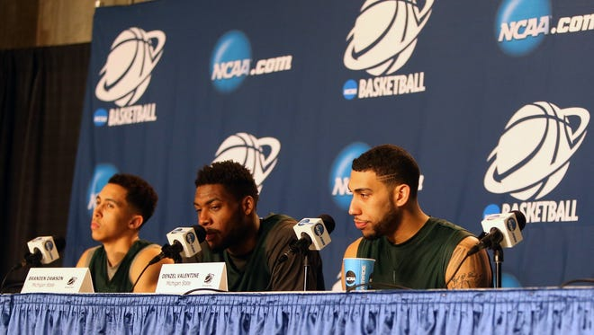 Michigan States Travis Trice, Branden Dawson and Denzel Valentine talk with reporters about their third round NCAA tournament game against Virginia on Saturday, March 21,2015 at the Time Warner Cable Arena in Charlotte North Carolina.