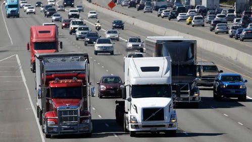 In this Wednesday, Aug. 24, 2016, photo, truck and automobile traffic mix on Interstate 5, headed north through Fife, Wash., near the Port of Tacoma.