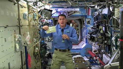 In this image taken from NASA video recorded on Friday, Nov. 18, 2016, NASA astronaut Shane Kimbrough shows a pouch of turkey he will be preparing for his crew in celebration of the Thanksgiving holiday, aboard the International Space Station. (NASA via AP)