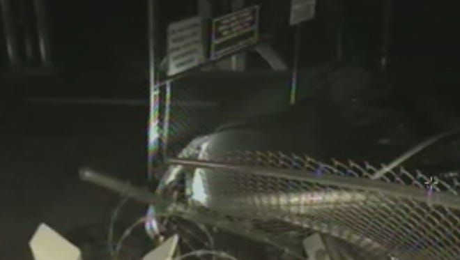 A security camera shows a car crashing through a gate leading to a Phoenix Sky Harbor International Airport runway in 2012.