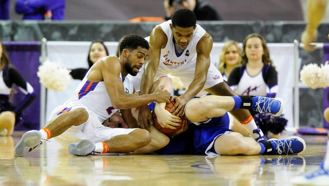 Evansville Aces guard Christian Benzon (2) and Evansville Aces guard Duane Gibson (25) and Drake Bulldogs forward Nick McGlynn (35) fight for possession during their game at the Ford Center in Evansville, Tuesday, Feb. 14, 2017. Evansville beat the Drake 87-70.