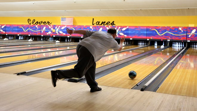 Mark Cheek,  of Fairport, is a longtime regular bowler at Clover Lanes.  He stopped by with his friends to bowl on the last day of operations for the bowling center which is closing after 59 years.