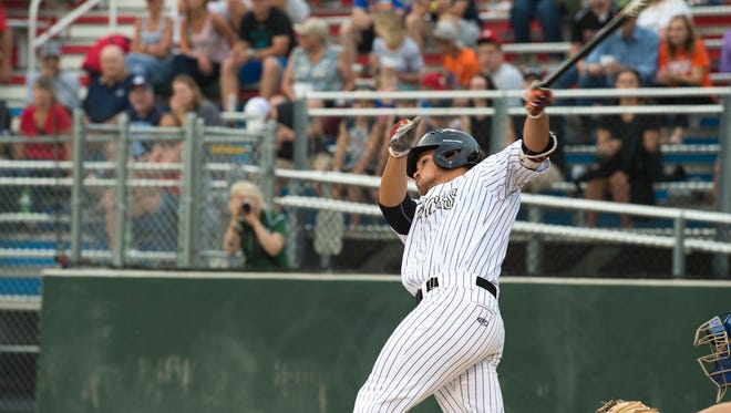Wisconsin Woodchucks's Stevie Mangrum singles home a run in the first inning of the Northwoods League All-Star Game Tuesday at Athletic Park