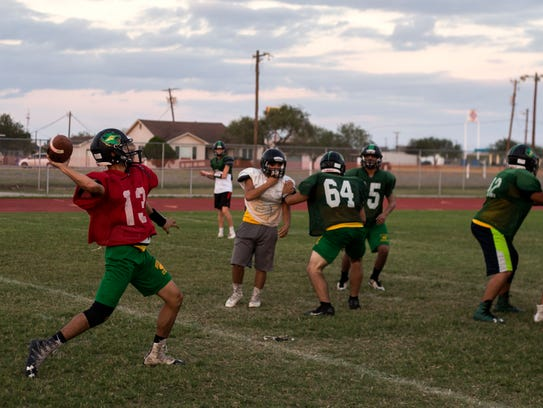 Bishop's Ramiro Carillo passes the ball during practice