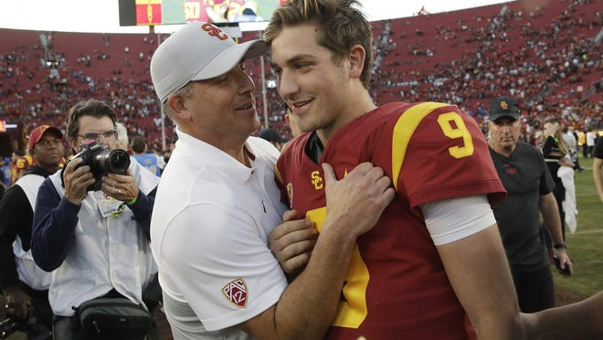 USC head coach Clay Helton, with quarterback Kedon Slovis after a 52-35 win over UCLA in November, has his 2021 recruiting class in the top 10 nationally, a big jump from his 2020 class, which ranked 55th.