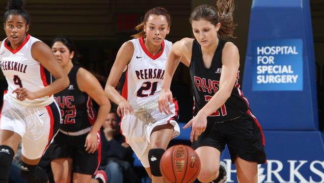 Peekskill's Lisana Burnett (21) chases Rye's Maddie Eck (21) during a Section 1 Class A girls basketball semifinal at the Westchester County Center Feb. 26, 2015.