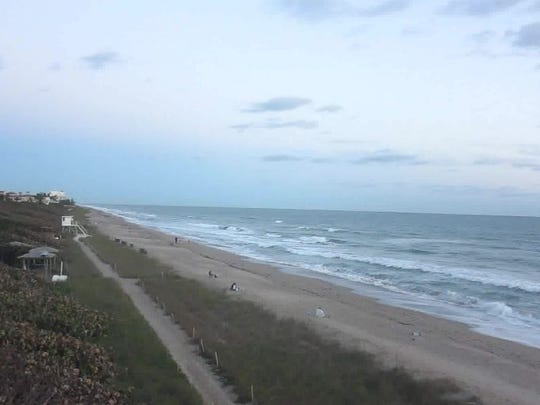 The morning wave watchers were bundled up at Jensen Beach on Saturday, Dec. 31, 2016.