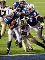 FILE - In this Feb. 7, 2010, file photo, Indianapolis Colts running back Joseph Addai (29) runs in a 4-yard touchdown as New Orleans Saints safety Darren Sharper (42) defends during the second half of NFL football's Super Bowl XLIV in Miami. The Saints won 31-17. (AP Photo/Chris O'Meara)