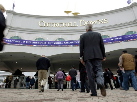 FILE - In this Nov. 4, 2011 file photo, fans arrive for the Breeders' Cup horse races at Churchill Downs, in Louisville, Ky. The Breeders' Cup is returning to its old Kentucky home. Churchill Downs and Breeders' Cup officials announced Monday, April 25, 2016, the race known for featuring the greatest horses and rich purses will return to the iconic twin spires in 2018. (AP Photo/Darron Cummings, File)