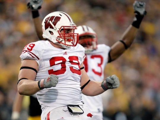 Wisconsin defensive tackle J.J. Watt celebrates his sack of  Iowa's Ricky Stanzi to set up 2nd and 21 inthe 4th quarter, stopping a drive and giving the Badgers a 31-30 win during the Wisconsin-Iowa BIg Ten football game Saturday, October 23, 2010. at Kinnick Stadium in Iowa City, Iowa.