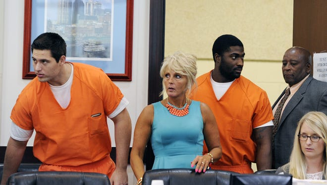 Former Vanderbilt football players Brandon Vandenburg,left, and Cory Batey,middle, appeared in court today with their defense attorneys to ask for a mistrial after learning that a juror did not disclose during jury selection he was a victim in a statutory rape case in Sumner County, Tenn. in 2000. The hearing was heard in front of Criminal Court Judge Monte Watkins on Monday, June 15, 2015 in Nashville, Tenn.