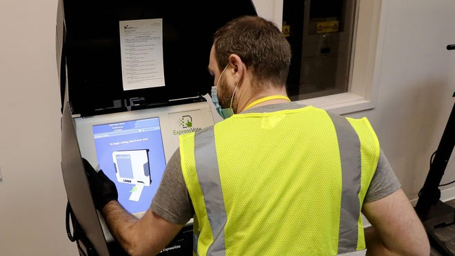 Poll worker Marcus Shull wipes down a voting machine after it was used on Election Day in April at the Franklin County Board of Elections in Columbus. Due to the COVID-19 pandemic, the primary election originally scheduled for March 17 was postponed and voters were instructed to request an absentee ballot for this election. Certain voters, including those disabled or homeless, were able to cast provisional ballots at the Board of Elections, and voters with absentee ballots were able to drop them off at the Board of Elections also while adhering to social distancing guidelines from the state health department.