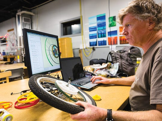 At Rochester Makerspace, Paul Flavin is designing a driving mechanism for a robot.