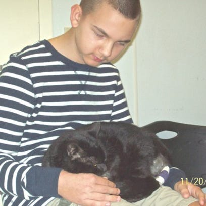 Josh bonds with his cat Andy.