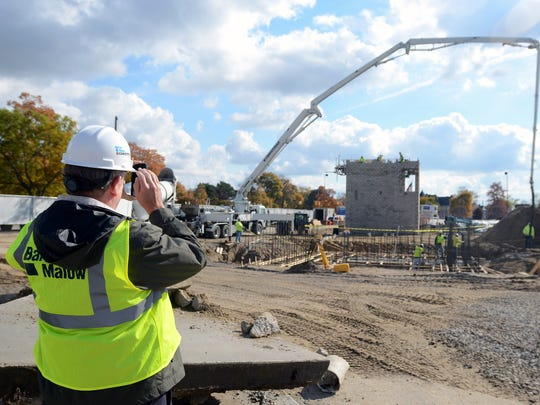 Crew member Jonathan Webster takes a photo of the construction Monday, Oct. 26, at Mclaren Port Huron.