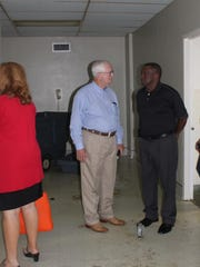 Pineville Mayor Clarence Fields (right) talks to Rapides Parish Sheriff William Earl Hilton on Monday during a tour of the closed Huey P. Long Medical Center building in Pineville. They agree it would be very expensive to get the building in shape to re-use it.