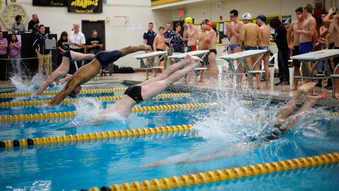 Swimmers make a start in the Waverly Relays Wednesday, Dec. 7, 2016, at Waverly High School.