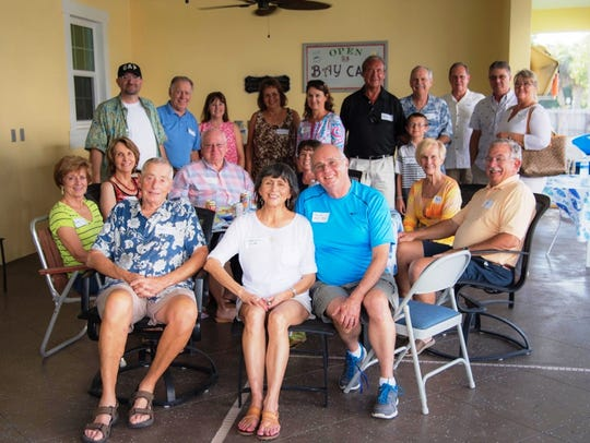A group of among 75 guests who attended the Cox's Open