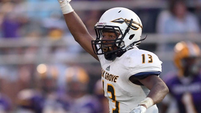 Oak Grove High School corner back Ben Johnson celebrates after a fumble in a game at Purvis on Friday.