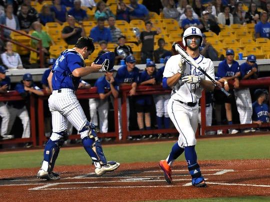 As Covington Catholic's catcher Alex Kennedy walks