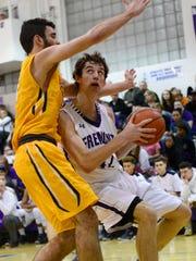 Ross' Steven Blodgett eyes the basket Friday night.