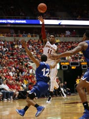 Iowa State's Monte Morris passes the ball during an exhibition game against Grand Valley State on Friday, Nov. 6, 2015 at Hilton Coliseum.