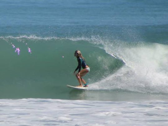 Nicole Williams enjoys the clear water and fun waves of second peak at Sebastian Inlet.