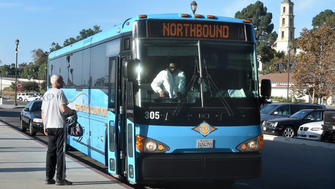 Brooks Engelhardt, of Camarillo, waits to board a Ventura County Transportation Commission bus Wednesday at the Camarillo Transportation Center. A proposed half-cent transportation sales tax measure, known as Measure AA, will be on the ballot countywide Nov. 8.