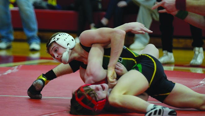 Devon Weber, 113-lbs., works on back points against Brennan Cantrell from Wellington.  Weber won the match by tech fall.  Weber went on to place first and will advance to state.
