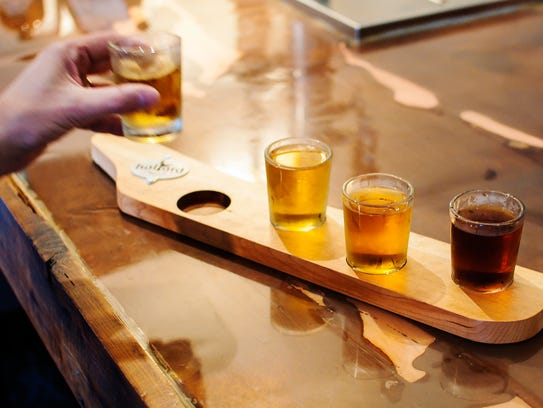 A flight of ginger beer is served at Halyard Brewing