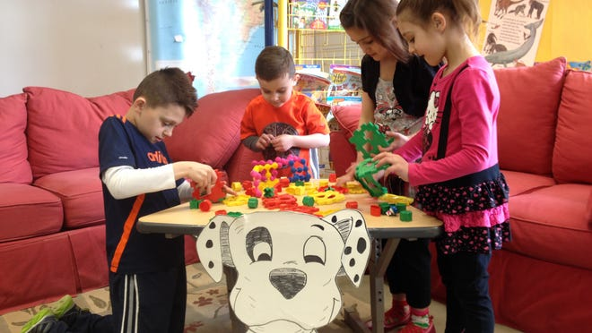 Children of the Grech family of Brighton occupy themselves in a clasroom play area at the planned charter school in the former Lindbom Elementary School. The Grech children, from left, are Michael, 9; Anthony, 4; Mary, 7; and Rita, 5.