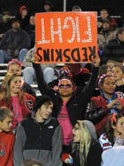Coshocton High School senior Kasey Means holds up a sign in support of the Redskins. Coshocton is in eastern Ohio.