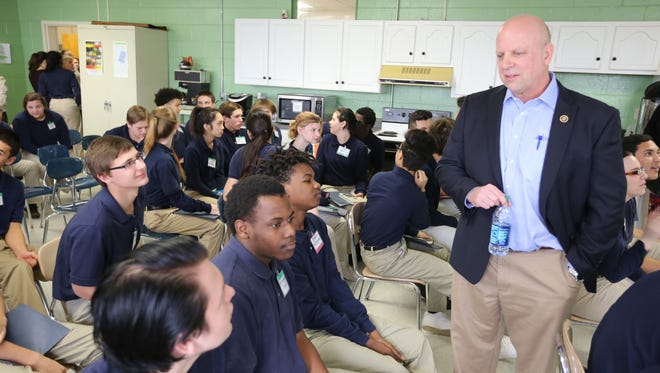 U.S. Rep. Scott DesJarlais, right, speaks with Daniel McKee Alternative School students Cameron Wise, left, Marcellus Davis, center, and Edrick Humphries during a visit to the Rutherford County school Monday morning.