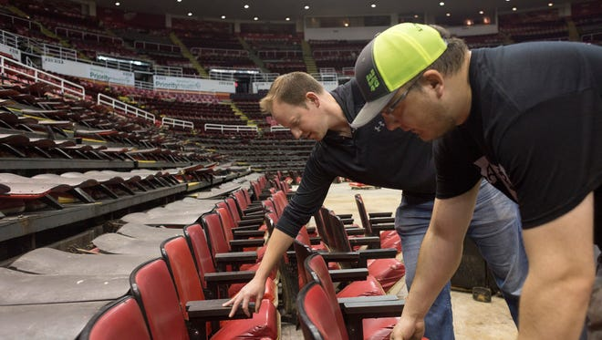 Brian Kean of Grosse Pointe, left, picks out stadium seats he purchased with the help of Ryan Johnson of Greenville at the Joe Louis Arena on Monday, May 14, 2018 in Detroit.